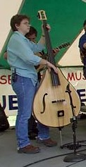 Beth White on mandolin-bass her mother built.